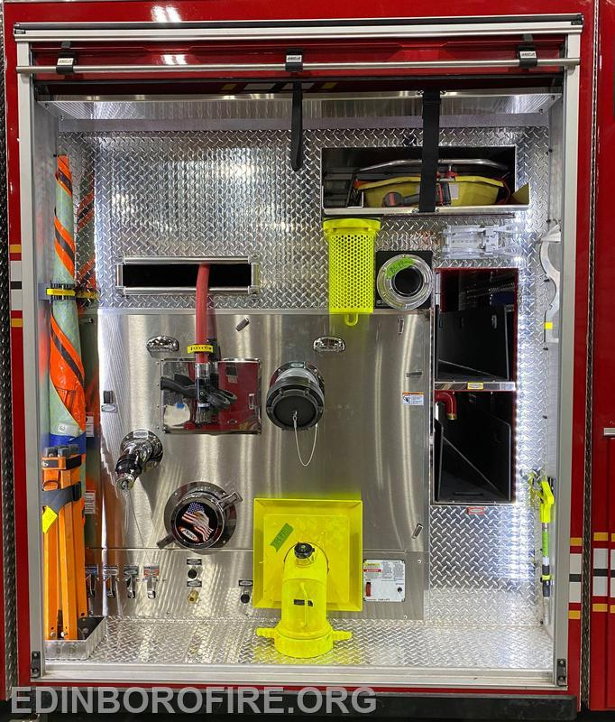 officers side pump panel with additional attachments and booster hose